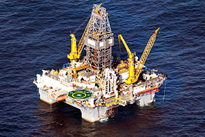 GULF OF MEXICO - MAY 09: A drilling platform is seen near the site where the Deepwater Horizon oil platform sank as work continues to contain the oil leak on May 9, 2010 in the Gulf of Mexico. The Deepwater Horizon oil rig operated by BP is leaking an estimated 5,000 barrels of oil a day into the Gulf and the slick has now reached nearby land. Efforts to contain the spill, including a 98-ton containment box to cap the leak, have done little to slow its flow. (Photo by Joe Raedle/Getty Images)
